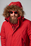 Man wearing red winter Alaska jacket  with fur hood on Stock Photos