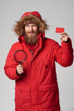 Man wearing red winter Alaska jacket with fur hood on Stock Photo