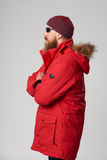 Man wearing red winter Alaska jacket  with fur hood on Royalty Free Stock Images