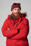 Man wearing red winter jacket Royalty Free Stock Photography