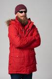 Man wearing red winter jacket and sunglasses Royalty Free Stock Photography