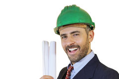 Man wearing a safety helmet holding blueprints Stock Image