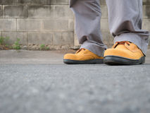 Man wearing safety shoes brown color. Close up of Man wearing safety shoes brown color , standing on the street Royalty Free Stock Images