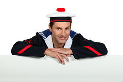 Man wearing sailor uniform Stock Images