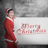 Man wearing santa claus costume holding banner with merry christmas writing Royalty Free Stock Images