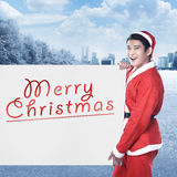 Man wearing santa claus costume holding banner with merry christmas writing Royalty Free Stock Photos