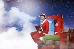 Man wearing santa claus costume sit on the big present box Stock Photo