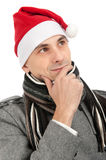 Man wearing a Santa Claus hat Stock Images