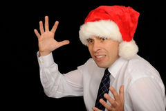 Man wearing Santa hat Royalty Free Stock Photos