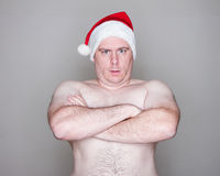 Man wearing a santa hat Stock Images
