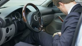 Man wearing seatbelt in car, safety concept, compliance with traffic rules. Stock footage stock footage