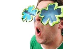 Shamrock Glasses Man. A man wearing shamrock glasses on St. Patrick`s Day Stock Photos