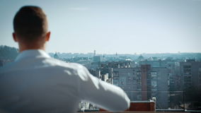 Man wearing shirt on the balcony stock footage