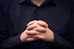 Man wearing shirt folded hands Stock Photo
