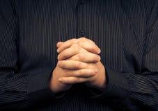 Man wearing shirt folded hands Stock Photography