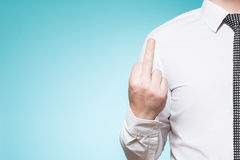 Man wearing shirt and tie showing middle finger Stock Photos