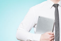 Man wearing shirt and tie with tablet pc Royalty Free Stock Photos