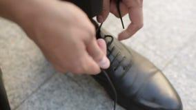 Man wearing shoes stock video