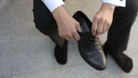 Man wearing shoes stock footage