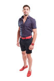 Man wearing shorts, purple shirt and pink belt and shoes Stock Photo