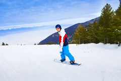 Man wearing ski mask standing on snowboard Royalty Free Stock Photography