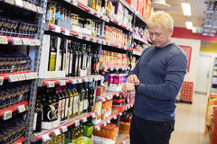 Man Wearing Smart Watch At Grocery Store Stock Image