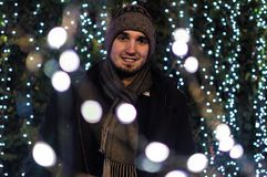 Man Wearing Snow Coat With Bokeh Light Background Stock Images
