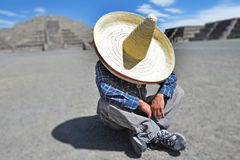 Man wearing Sombrero hat having a siesta/nap in Mexico. Man wearing Sombrero hat having a siesta, an afternoon rest or nap, especially one taken during the royalty free stock images