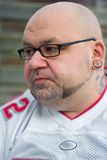 Man wearing specs. Portrait of a handsome man with tattoo on his chin Royalty Free Stock Photos