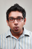 A man wearing spectacle. Man wearing spectacle shows a wow expression royalty free stock images