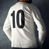 Man wearing sport shirt with number ten. Printed ion his back Stock Photography