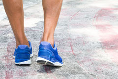 Man wearing sport shoes walking on old concrete gym floor, sport. Concept Royalty Free Stock Photography
