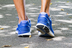 Man wearing sport shoes walking in the park. Sport concept Stock Image