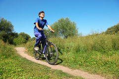 Man Wearing Sporty Clothes Is Riding On Bycicle Royalty Free Stock Photos