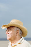 Man wearing a straw cowboy hat Royalty Free Stock Photography