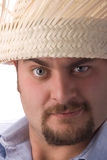 Man wearing straw hat Royalty Free Stock Image