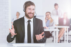 Man wearing suit and headset Royalty Free Stock Photography