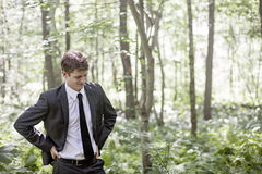 Man wearing suit in nature Stock Photos
