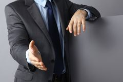 Man wearing a suit offering to shake hands Royalty Free Stock Photo
