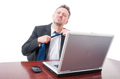 Man wearing suit at office being very tired Royalty Free Stock Photos