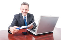Man wearing suit at office holding stapler and documents royalty free stock images