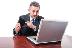 Man wearing suit at officelooking sad with empty wallet Royalty Free Stock Images