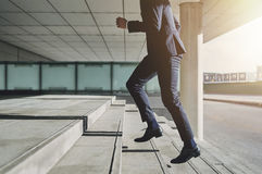 Man wearing suit runs up the stairs Royalty Free Stock Photo