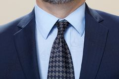 Man wearing suit with tie in close up Royalty Free Stock Photo