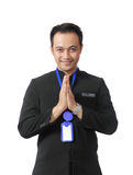 Man wearing suit with welcome smile royalty free stock photography