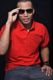 Man wearing sunglasses. This picture represents a  young man wearing sunglasses Stock Images