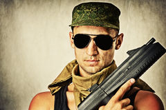 Man wearing sunglasses with automatiс Stock Photos