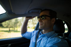 Man wearing sunglasses in car. Man wearing sunglasses while driving car Royalty Free Stock Photos