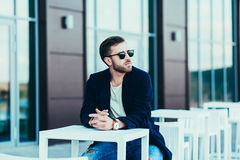 Man wearing sunglasses and jeans Royalty Free Stock Images