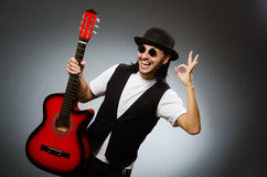 Man wearing sunglasses and playing guitar Royalty Free Stock Image